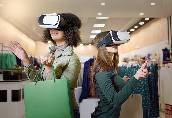 two women trying clothes with a VR device